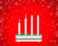 Advent candlestick with two burning candles second sunday of on red background snowflakes Stock Photography