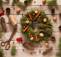 Advent Christmas wreath decoration with natural decorations, pine cones spruce, nuts, candied fruit on wooden background Royalty Free Stock Photo