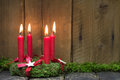 Advent or christmas wreath with four red wax candles. Royalty Free Stock Photo