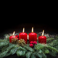 Advent decoration red burning candles christmas tree black Royalty Free Stock Photo