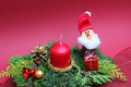Advent spray with candle and santa clause handmade gnome Royalty Free Stock Photos