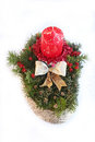 Advent spray with red candle golden ribbon and jew branch with on slice of tree berries Stock Photos