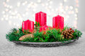 Advent wreath christmas floral decorations with lights in the background Stock Image
