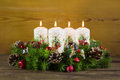 Advent wreath or crown with four burning white candles. Royalty Free Stock Photo