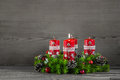 Advent wreath or crown with four red candles on wooden backgroun Royalty Free Stock Photo