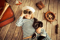 Adventure happy kid dressed in sailor child playing with dog at home travel and concept Royalty Free Stock Photos