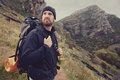 Adventure man potrait of trekking in mountains with backpack Royalty Free Stock Photo