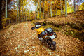 Adventure motorbike in forest during autumn season Stock Images