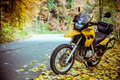Adventure motorbike on road in autumn season Stock Photos