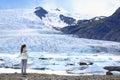 Adventure woman by glacier nature on iceland tourist in icelandic sweater glacial lagoon lake of fjallsarlon vatna Royalty Free Stock Photos