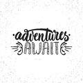 Adventures await - hand drawn lettering phrase on the white grunge background. Fun brush ink inscription for Royalty Free Stock Photo