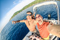 Adventurous best friends taking selfie at giglio island on luxury speedboat adventure travel lifestyle enjoying happy fun moment Royalty Free Stock Photography