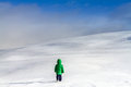 An adventurous little boy walking near the clouds on the high mountains child in action snow in winter across ocean of snow in Royalty Free Stock Images