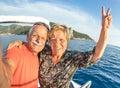 Adventurous senior couple taking selfie at giglio island on luxury speedboat active elderly travel lifestyle concept on happy tour Stock Image