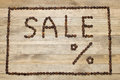 Advert sale made of coffee beans on wooden backgrounds Royalty Free Stock Images