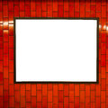 Advertisement empty poster space frame on the brick red wall on subway station Royalty Free Stock Photo
