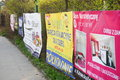 Advertisement posters row of on a metal grid fence in poznan poland Stock Photos