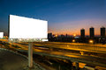 Advertising blank billboard at twilight. Royalty Free Stock Photo