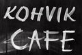 Advertising chalkboard of street cafe with text label on english and estonian Royalty Free Stock Images