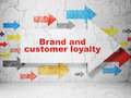 Advertising concept: arrow with Brand and Customer loyalty on grunge wall background