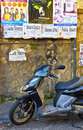 Advertising Posters and Motor Scooter, Italy Royalty Free Stock Photo