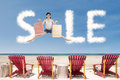 Advertising sale clouds and girl jumping over beach chairs Royalty Free Stock Photo