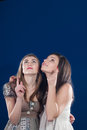Advertising two beautiful young women showing Stock Photo