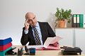 Advisor compares calculations checks documents Royalty Free Stock Photography
