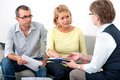 Advisory service for debtors mature couple getting financial advice from consultant at home Royalty Free Stock Images