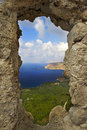 Aegean sea blue sky stone window Stock Photo