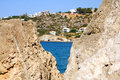 Aegean sea a blue triangle of accross a rock at the beach in crete in greece Stock Images