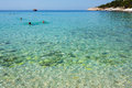 Aegean sea in greece and tourists swimming Royalty Free Stock Photos
