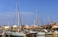 Aegina harbour luxury yachts lined up in the main town s on island in the argo saronic gulf south of athens greece in the autumn Stock Photo