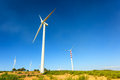 Aeolian turbines in calabria among green fields Royalty Free Stock Image