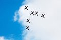 Aerial acrobatics planes flying in tight formation at airshow Royalty Free Stock Images
