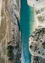 Aerial bird`s eye view photo taken by drone of famous Corinth Canal with turquoise water, Peloponnese, Greece. The Royalty Free Stock Photo