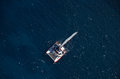 Aerial catamaran helicopter view of over deep blue sea Stock Image