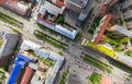 Aerial city view with crossroads and roads, houses buildings. Copter shot. Panoramic image. Royalty Free Stock Photo