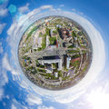 Aerial city view with crossroads and roads, houses buildings. Copter shot. Panoramic image.