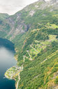 Aerial close up view of a zig zag winding road going up a steep slope near geiranger norway with some traffics Royalty Free Stock Image