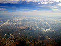 Aerial cloudscape with city below Royalty Free Stock Photo