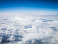 Aerial cloudscape in stratosphere sky shot from airplane window Stock Photos