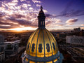 Aerial Drone Photograph - Stunning golden sunset over the Colorado state capital building & Rocky Mountains, Denver Colorado. Royalty Free Stock Photo
