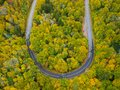 Aerial drone view of U Turn Road Curve in Autumn / Fall foliage overhead. Blue Ridge in the Appalachian Mountains near Asheville, Royalty Free Stock Photo