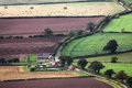 Aerial farm buildings and fields farmland meadows england uk Stock Photos