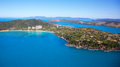 Aerial of hamilton island in the whitsundays queensland australia reef and boats seen in the blue ocean with the resorts along the Stock Images