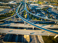 Aerial High View over texas Highway Exchange Overpass Traffic Transportation Urban Sprawl Royalty Free Stock Photo