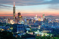 Aerial panorama of Downtown Taipei City with Taipei 101 Tower among skyscrapers under dramatic sunset sky Royalty Free Stock Photo