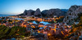 Aerial Panorama of Omis and Cetina River Gorge in the Evening