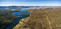 Aerial panorama of Snowy River flowing among green hills of Aust Royalty Free Stock Photo